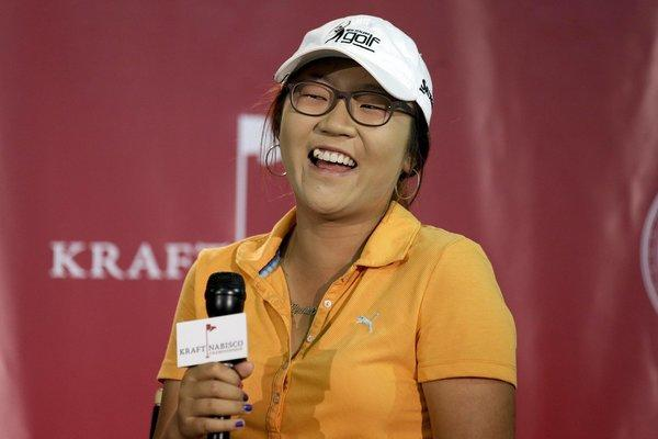 Lydia Ko chuckles during a news conference on Wednesday at the LPGA Kraft Nabisco Championship.