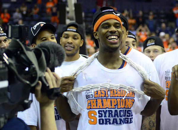 C.J. Fair celebrates Syracuse's win over Marquette in the Elite Eight.