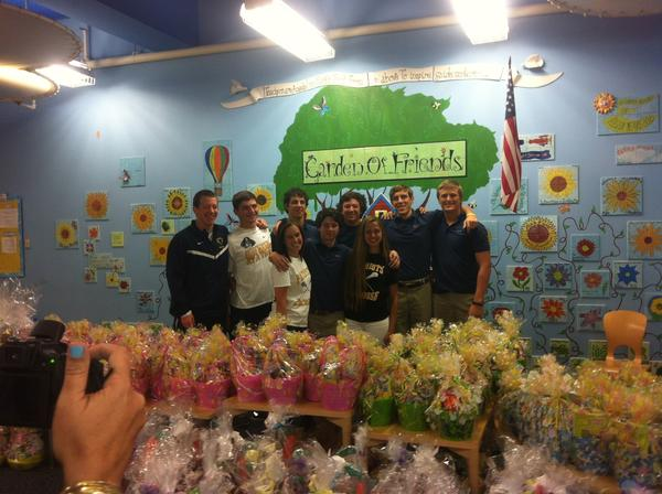 American Heritage lacrosse players Erika Mazer and Daniella Pacitti, with the help of their teammates and St. Thomas Aquinas boys lacrosse players, made 165 Easter baskets for needy children. Courtesy photo