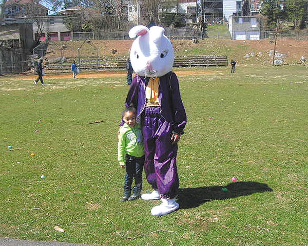 Ka'Naiyah Cheese is shown with the Easter Bunny, played by Jasmine Johnson, at the Easter egg hunt hosted by Memorial Recreation Center.