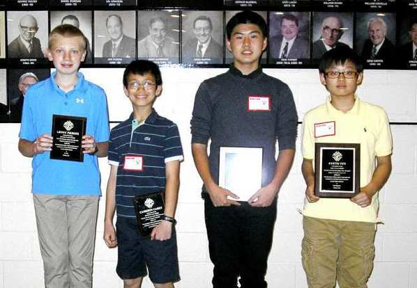 Winners of the Crescenta Valley Council of the Knights of Columbus' 16th annual Spelling Bee are, from left, Lenny Pieroni, 7th-8th Grade Runner Up; Cameron Carey, 4th-5th-6th Grade Runner Up; Darren Kim, 7th-8th Grade Champion; and Curtis Yun, 4th-5th-6th Grade Champion.