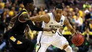 Michigan point guard Trey Burke, who helped the Wolverines reach the Final Four for the first time since 1993, and Miami's Jim Larranaga have been selected the Associated Press' player and coach of the year.