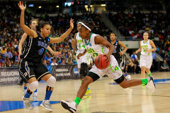 Jewell Loyd drives on Duke's Chloe Wells in Tuesday's regional final.