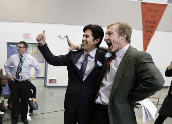 Sen. Kevin de León (D-Los Angeles) joins Tom Steyer, right, who bankrolled the campaign for Proposition 39, at a Sacramento event promoting the ballot initiative on Dec. 4, 2012.