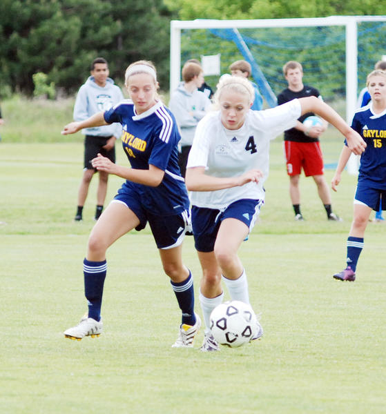 Morgan Jons (right) is one of 13 seniors of the roster this season for the four-time defending Big North champion Petoskey High School girls soccer team. The Northmen open the 2013 season with a Big North Conference match at West Branch Ogemaw Heights on Thursday, April 11.
