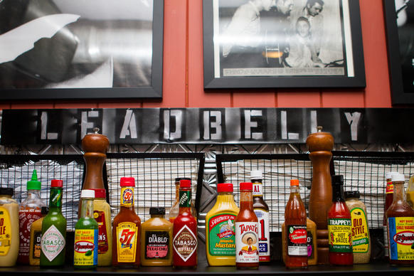 "The condiment collection at <a href=""http://chicago.metromix.com/venues/mmxchi-leadbelly-venue"">Leadbelly</a> in Portage Park"