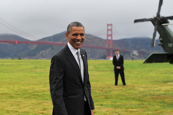 President Obama smiles before boarding the Marine One helicopter in a field overlooking the Golden Gate Bridge in San Francisco on Thursday.