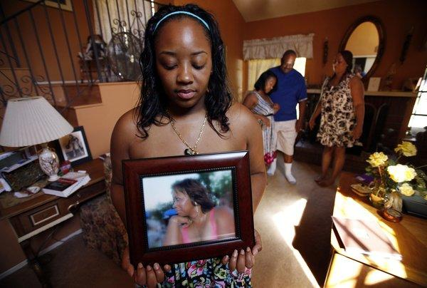 Khristina Henry holds a photo of her mother, Pamela Lark. Lark was killed in 2007 by Tyquan Knox, days before Khristina was scheduled to testify against Knox in a robbery case. On Thursday, Knox's then-girlfriend confessed to driving Knox to and from the shooting.