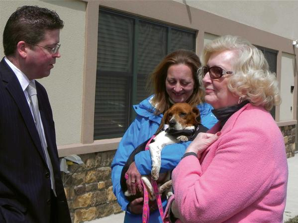 Franklin County Commissioner David Keller and Chambersburg Borough Councilwoman Peggy Shank, right, talk with Connie Woody, a Cumberland Valley Animal Shelter animal care technician, who's holding Betty Jo, a beagle up for adoption.