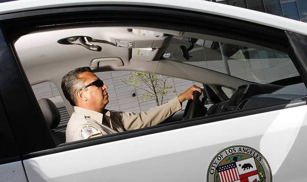 "Parking enforcement officer Richard Garcia has patrolled the streets of L.A. for 27 years. He sometimes feels like he's in a battle he can't win: ""There's just no more space and there's more and more vehicles."""