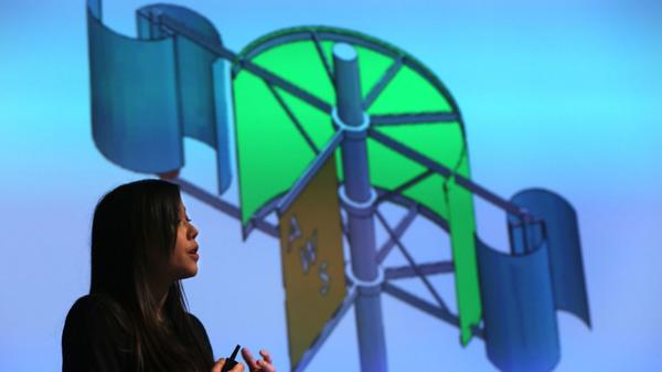 Niki Zmij from Cleveland State University presents Amplified Wind Solutions, a wind amplification system that can operate in low wind speed and produce up to six times more electricity than a conventional turbine., at the Clean Energy Challenge Thursday.