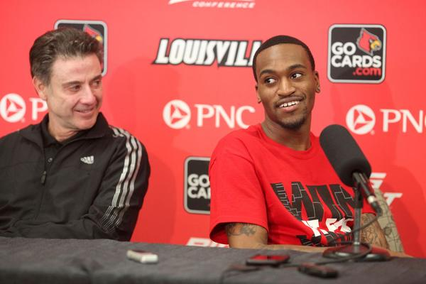 Louisville coach Rick Pitino, left and Cardinals player Kevin Ware talking to reporters Wednesday.