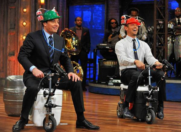 "Jimmy Fallon and Josh Duhamel take part in ""Cooler Races"" during a taping of ""Late Night With Jimmy Fallon."""