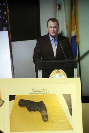 Long Beach police show off water device in shooting.