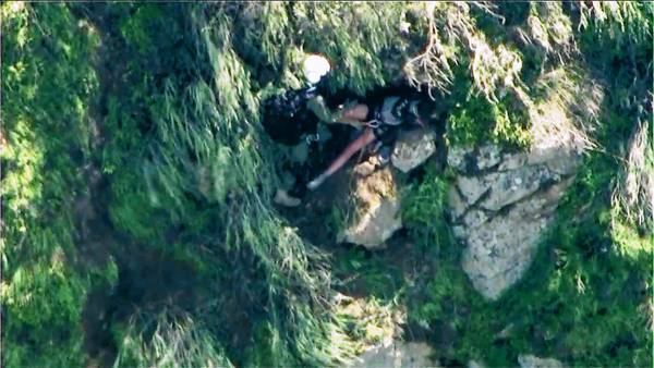 Rescuers prepare to airlift Kyndall Jack, 18, from a cliff in the Trabuco Canyon area; she had been missing since Sunday.