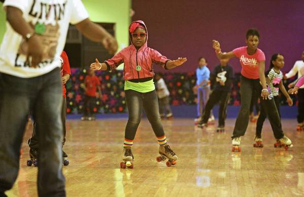 Children skate last month at the city-owned Markham Roller Rink in south suburban Markham.