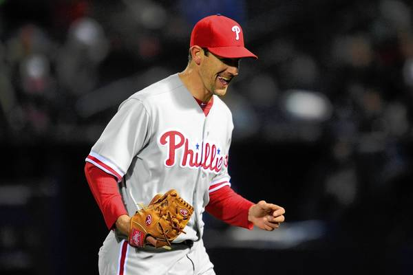 Philadelphia Phillies starting pitcher Cliff Lee (33) reacts after striking out Atlanta Braves center fielder B.J. Upton (not shown) to end the seventh inning at Turner Field on Thursday night.