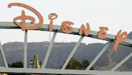 A part of the signage at the main gate of The Walt Disney Co. is pictured in Burbank (Fred Prouser Reuters, / May 9, 2012)
