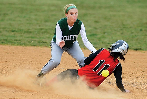 North Hagerstown's Laken Feeser slides safely into second base ahead of the throw to South Hagerstown shortstop Ashlyn Hinkle during Thursday's game at South.