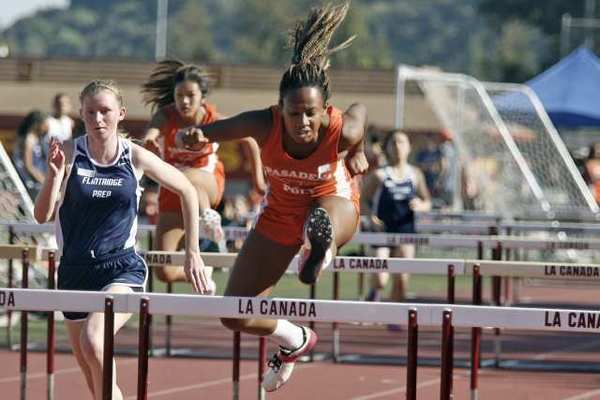 Pasadena Poly's Simone Abegunrin runs in the hurdles event during a tri-Prep League track and field meet between the Panthers, Flintridge Prep and Westridge.