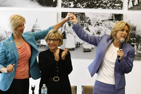 U.S. Rep. Janice Hahn, left, holds up the hand of L.A. mayoral candidate Wendy Greuel as Sen. Barbara Boxer claps at a meeting of The Feminist Majority in Beverly Hills.