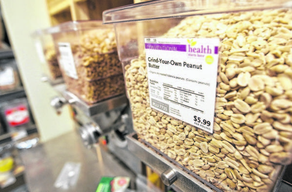 A station is available for customers to grind their own peanut butter inside the new Whole Foods in Mishawaka.