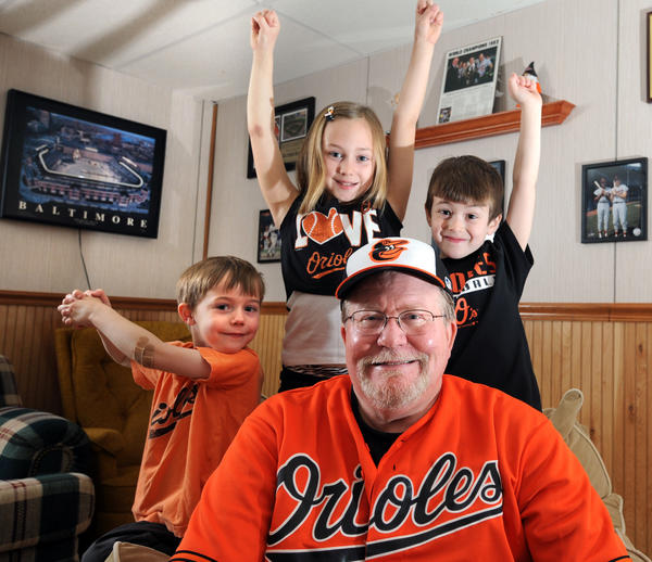 Don Crocetti bought Orioles season tickets so he can take his grandchildren to games. The grandchildren, from left, are: London Holmes, 5; Sydney Holmes, 8; and Ethan Jimenez, 5.