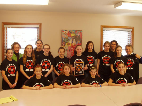 The Harbor Springs U-13 girls' soccer team presents a donation to staff members of the Women's Resource Center of Northern Michigan: (front row, from left) Laura Graham, Chloe Hogan, Laenie Backus, Alyssa Hunt; (middle row) Clara Pater, Madison Hunt, Alison Fought, Erika Crandell, Martha Johnson, Jillian Spierling, Ally Hoffman, Ellie Fleming; (back row) Chris Krajewski, domestic abuse and sexual assault program director; Cindy Hunt, coach; Anne Fleming, coach; and Jan Mancinelli, women's center executive director. Team members not pictured, Emma Wagner, Lauren Johansen, Madi Bezilla and Adriana Kirby.
