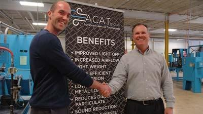 Joe A. Moch (left), a partner in Advanced Clean Air Technologies (ACAT), shakes hands with Mark Snyder, a Realtor with Prudential Preferred Properties, at ACATs manufacturing site just south of Charlevoix. ACAT recently acquired the site along M-66, for which Snyder served as listing agent.