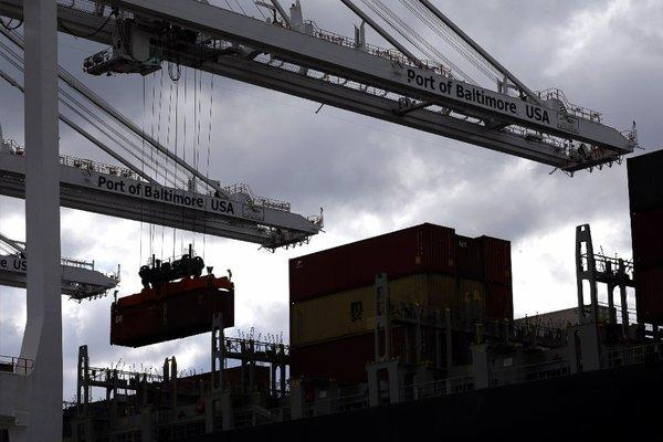 A crane removes a container from a ship at the Port of Baltimore's Seagirt Marine Terminal.