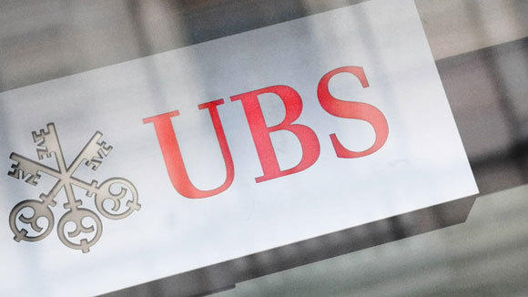 The logo of Swiss bank UBS is seen on a building in Zurich.