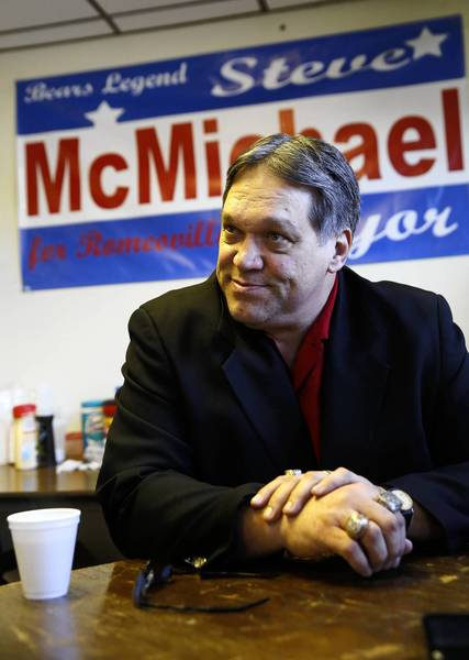 "Former Chicago Bears defensive lineman Steve ""Mongo"" McMichael talks about the Romeoville mayoral race Tuesday at his campaign office."