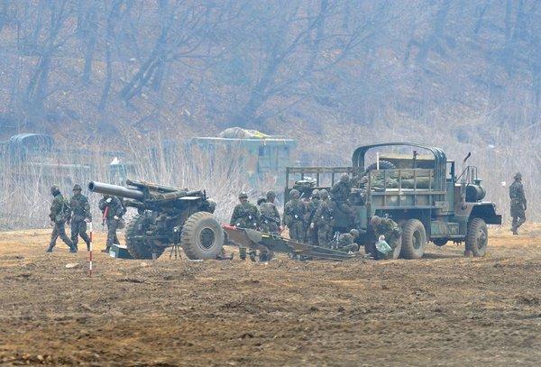 South Korean soldiers man a cannon at a military training field near the border city of Paju.