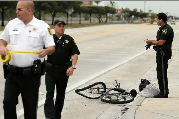 Broward Sherrif's Office deputies work the scene of a fatal accident involving a bicyclist in the roadway on Dixie Hwy. just south of NE 48th Street in Deerfield Beach on Friday, April 5, 2013.