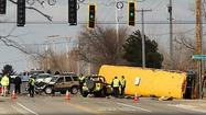 Authorities are investigating whether a school bus driver ran a red light before colliding with two SUVs near Wadsworth yesterday, killing a driver of one of the vehicles and injuring dozens of elementary students on board.