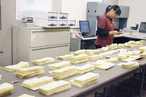 Ballots are sorted during the primary election at Burbank City Hall in February.