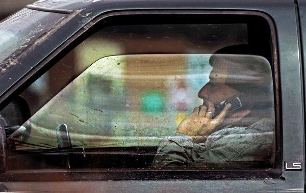 A driver talks on the phone on Tuesday in Montpelier, Vt. The National Highway Traffic Safety Administration says that there are 660,000 distracted drivers on the road at any given moment of the day.