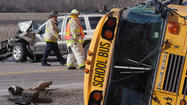 A school bus driver may have driven through a red light before his vehicle collided with two others, leaving one adult dead and more than two dozen students injured, officials said on Friday.