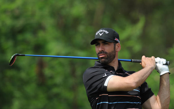 Alvaro Quiros of Spain plays a shot during the Avantha Masters golf tournament in Greater Noida on the outskirts of New Delhi on March 14.