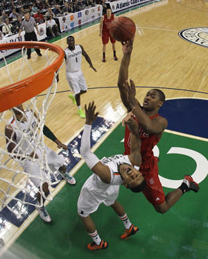 Rodney Purvis goes up for a dunk over Miami's Trey McKinney Jones in the ACC Tournament on March 16, 2013.