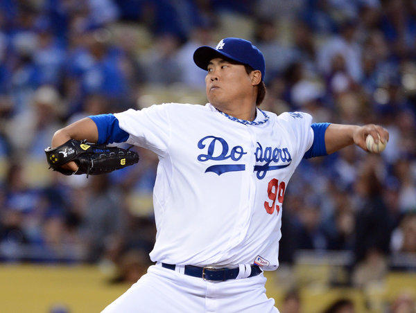 Hyun-jin Ryu of the Los Angeles Dodgers makes his first pitch against the San Francisco Giants at Dodger Stadium.