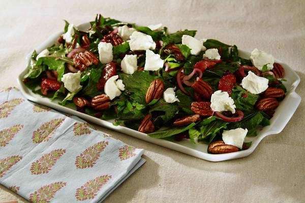Dandelion greens are complemented with blood oranges, goat cheese and pecans in a salad with a bit of bite.