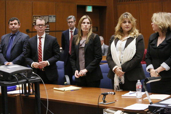 "Yevgeny ""Eugene"" Selivanov, far left, and Tatyana Berkovich, second from right, were found guilty Friday of several charges related to a case involving the taking or misappropriating of more than $200,000 in public funds."