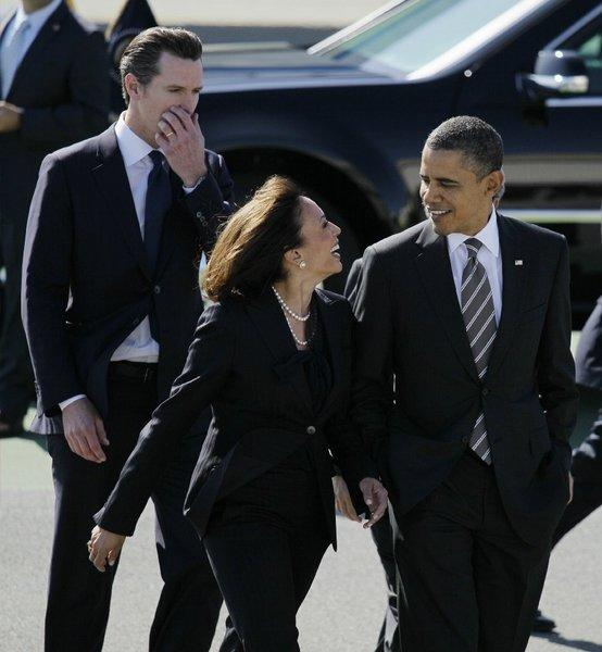"President Obama arrives at San Francisco International Airport and is greeted by California Atty. Gen. Kamala Harris and Lt. Gov. Gavin Newsom. The president was at an Atherton fundraiser when he joked about Harris as the nation's ""best-looking"" attorney general."