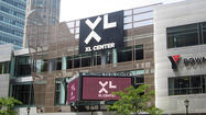 The city of Hartford would lease the XL Center to the state under a proposed 10-year agreement that would guarantee the city annual payments of $3 million in the first two years, the state's budget director said Friday.