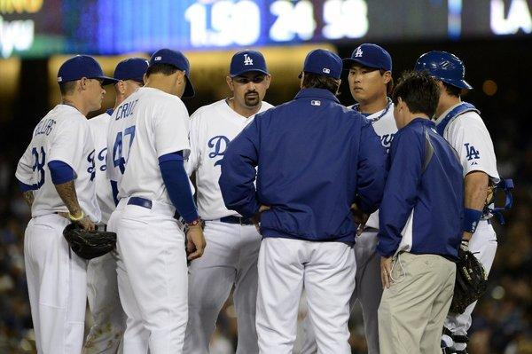 Dodgers manager Don Mattingly meets with his team in the seventh inning against the San Francisco Giants on Tuesday.