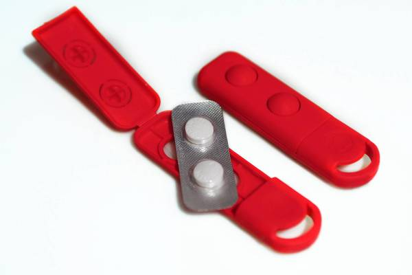 The little red packet with aspirin can be kept on a key chain to be used in case of a heart attack.