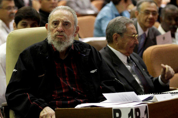 Former Cuban president Fidel Castro, left. sitting next to his brother and current president, Raul, as Cuba's new National Assembly meets February 24.
