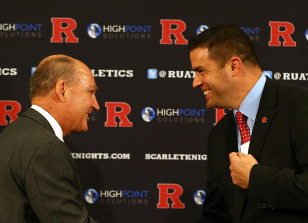 Big Ten commissioner Jim Delany (left) shakes hands with Tim Pernetti during a press conference announcing that Rutgers University is joining the Big Ten Conference.