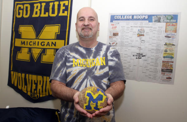 A rock fashioned by his granddaughter, Sage, now 11, of Sturgis, is one of the many items in the Niles apartment of Eddie Groves that reflects Groves allegiance to the University of Michigan. Groves said he picked Michigan to win the mens basketball NCAA tournament but conceded he also filled out a bracket that had Miami winning the championship. (South Bend Tribune/GREG SWIERCZ)